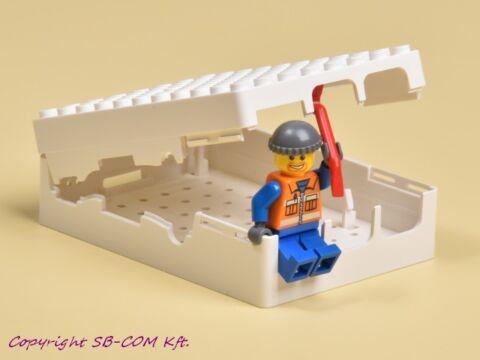 Fehér Lego kompatibilis doboz Raspberry Pi-hez nyitott tetővel és Lego figurával